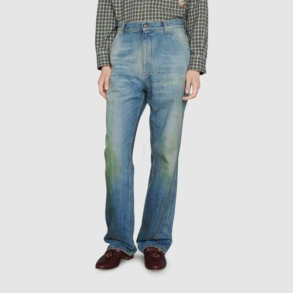 мужские джинсы Gucci с пятнами от травы